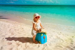 Cute little girl travel on summer beach. Cute little girl travel on summer tropical beach Royalty Free Stock Photos