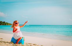 Cute little girl travel on summer beach. Cute little girl travel on summer tropical beach Stock Photo