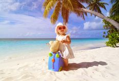 Cute little girl travel on summer beach Stock Photo
