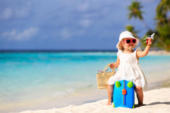 Cute little girl travel on summer beach Royalty Free Stock Image