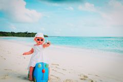 Cute little girl travel on summer beach. Cute little girl travel on summer tropical beach Stock Image