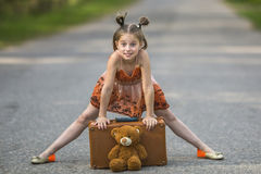 Cute little girl traveler is on the road. Happy. Stock Photos