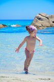 Cute little girl on tropical beach Stock Image
