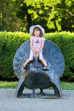 Cute little girl on a turkey statue Royalty Free Stock Photography