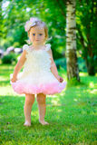 Cute little girl in tutu at park Stock Image