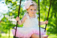 Cute little girl in tutu swinging Stock Photos