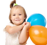 Cute little girl with two colored balloons Stock Image