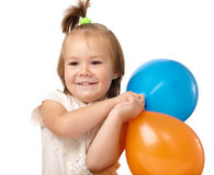 Cute little girl with two colored balloons Royalty Free Stock Photography