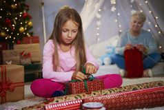 Girl wrapping gifts Stock Photos