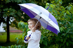 Cute little girl with umbrella Royalty Free Stock Photography