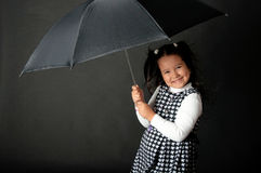 Cute little girl with umbrella Stock Photo
