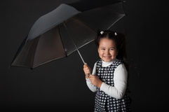 Cute little girl with umbrella Stock Photography