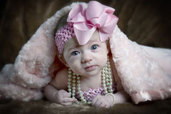 Cute little girl under blanket Royalty Free Stock Photography