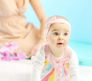 Cute little girl under mom's sight Stock Image