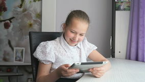 Cute little girl uses a digital tablet computer stock video footage
