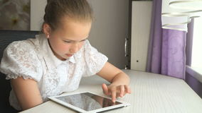 Cute little girl uses a digital tablet computer stock video