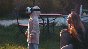 A cute little girl uses a virtual reality helmet stock video footage
