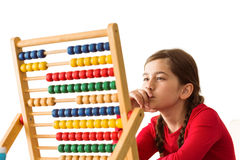 Cute little girl using an abacus Royalty Free Stock Images