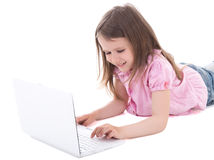 Cute little girl using laptop isolated on white Stock Photo