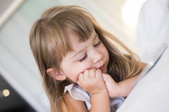 Cute Little girl using mobile phone at home Stock Photography