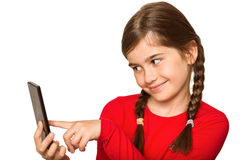 Cute little girl using smartphone Stock Photography