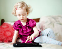 Cute little girl using tablet Royalty Free Stock Photography