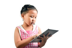 Cute Little Girl Using Technology. On White Background Royalty Free Stock Photography