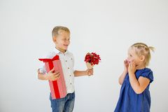 Kids Valentine day. Cute little girl with a valentine postcard royalty free stock photo