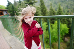 Cute little girl on a very windy day Royalty Free Stock Image