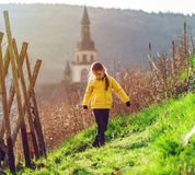 Cute little girl in vineyards, spring sunny day Stock Photo
