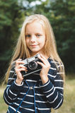 Cute little girl with a vintage rangefinder camera. Stock Photos