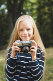 Cute little girl with a vintage rangefinder camera. Stock Image