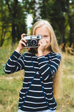 Cute little girl with a vintage rangefinder camera. Royalty Free Stock Photo