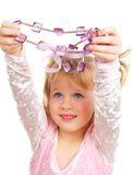 Cute little girl and violet beads Stock Photos