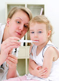 Cute little girl visiting pediatrician Stock Images