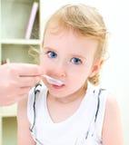 Cute little girl visiting pediatrician Royalty Free Stock Photos