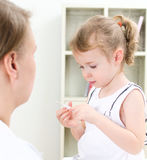 Cute little girl visiting pediatrician Royalty Free Stock Images