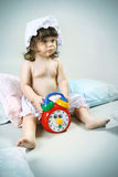 Cute little girl waking up in the morning and swit Royalty Free Stock Photos