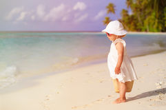 Cute little girl with walking on beach Royalty Free Stock Images