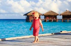 Cute little girl walking on beach resort Royalty Free Stock Photo