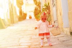 Cute little girl walking in the city Royalty Free Stock Photos