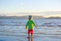 Cute Little girl walking on Coromandel beach, NZ Royalty Free Stock Image