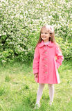 Cute little girl walking in the park Stock Image