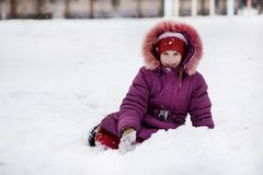 Cute little girl walking in snow park, happy childhood stock photos