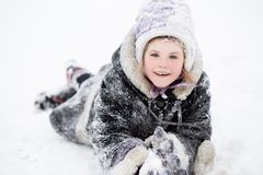 Cute little girl walking in snow park, happy childhood royalty free stock photography