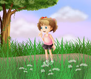 A cute little girl walking in the street Royalty Free Stock Photography