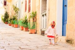 Cute little girl walking on the street of Malta Stock Image