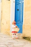 Cute little girl walking on the street of Malta Royalty Free Stock Image