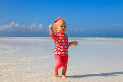 Cute little girl walking on summer beach Royalty Free Stock Images
