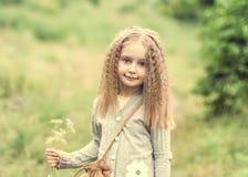 Cute little girl is walking in summer stock photos